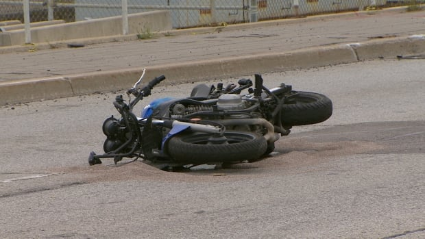 A man has died after his motorcycle was struck by an SUV early Tuesday/