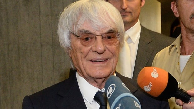 Bernie Ecclestone, the head of Formula One racing, gives an interview Tuesday while leaving the Oberlandesgericht Muenchen courthouse after judges agreed to conclude his trial for bribery. Ecclestone will pay $100 million US to settle the case.