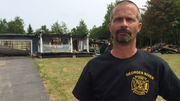 Georges River Fire Chief Travis Briand at the scene of last week's fire. He said he is looking for at least 10 new volunteers to join his department.