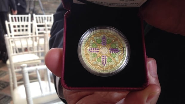 The coin is a tribute to the stained glass McCausland dome that covers Casa Loma's conservatory.