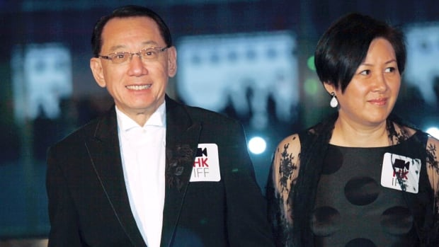 Albert Yeung, chairman of the Hong Kong media conglomerate Emperor Entertainment Group appears with his wife in a 2009 photo. A court has ruled that the Yeungcan sue Google over its autocomplete results suggesting he has links to organized crime.