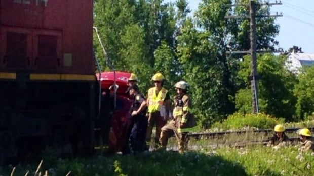 A westbound freight train hit a car at the Tate Road crossing west of Trenton, Ont., shortly after 10 a.m. ET.