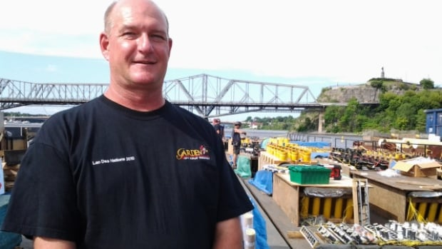 Garden City Display Fireworks owner Michael Bohonos stands next to his barge full of fireworks.