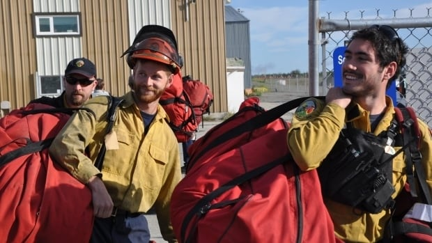 Yukon firefighters leave Whitehorse for Fort Smith, N.W.T., earlier this summer.