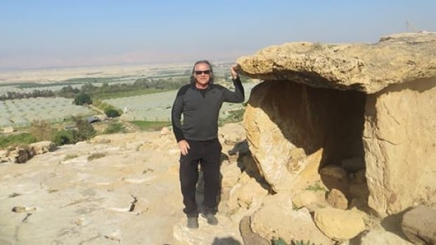 Dolmen stones are found around the world, says adventurer Bill Steer. The rectangular stones Bill Steer stands next to in this picture were found in Israel's Jordan River Valley.