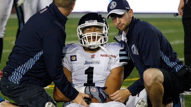 Argos receiver Anthony Coombs, seen here being tended to by the CFL team's training staff during Friday's game in Montreal, suffered a torn labrum in his shoulder that could cut short his season. He joins fellow pass-catchers Andre Durie, Chad Owens and Jason