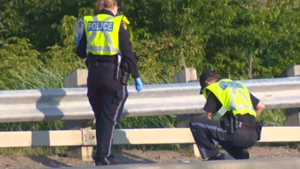 Police investigate the scene near Highway 400 and King Road, north of Toronto, where a woman was found dead early Thursday morning.