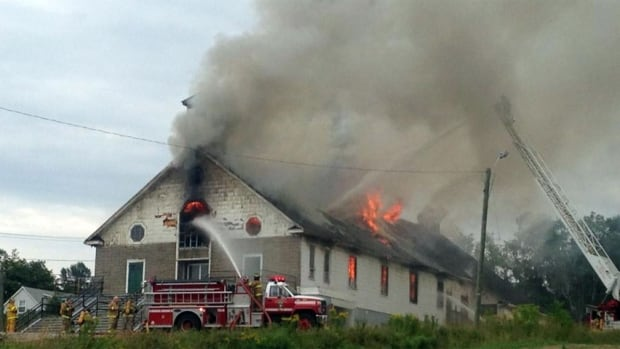 Former St. Theresa Child of Jesus Catholic Church on fire in Bathurst
