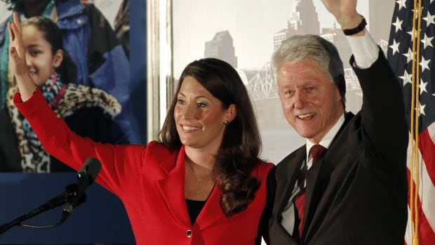Former president Bill Clinton joins U.S. Democratic Senate candidate Alison Lundergan Grimes for a campaign event in Louisville, Ky., in February. Grimes is running against Senate Minority Leader Mitch McConnell and has accused him of not caring about women and treating them unfairly.