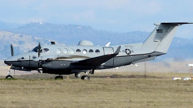 The U.S. government is selling surplus MC-12W reconnaissance planes similar to this one, which are outfitted with the same type of sensors used in drone aircraft.