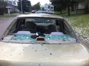 Aug. 7: Golf ball-sized hail caused extensive damage to vehicles and homes in the Airdrie area late Thursday afternoon.