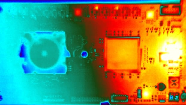 The TrueNorth chip (left) has very low power consumption, making it far cooler than the regular chip that is feeding information into it (right).
