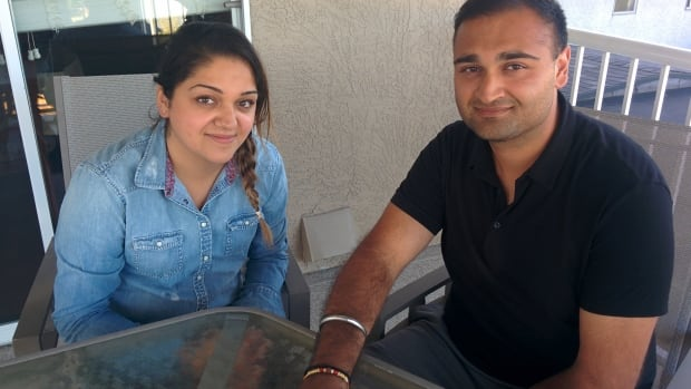 Amar Bhatti (right) wears a rakhi tied on by his sister Raj (left).