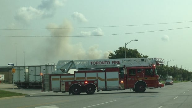 A fire engine responds to a blaze at a paper manufacturer near Kipling Avenue and the Gardiner Expressway.