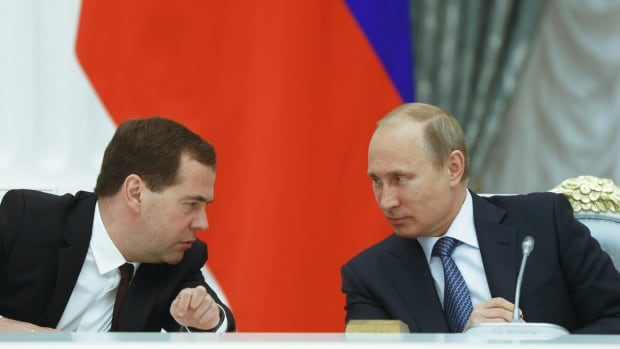 "Russian President Vladimir Putin, right, is seen talking Prime Minister Dmitry Medvedev in May, not long after saying that the internet was a ""CIA project."""