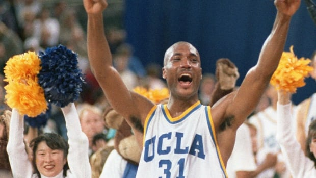 In this 1995 photo, UCLA's Ed O'Bannon celebrates after his team won the NCAA title against Arkansas. A federal judge has ruled that the NCAA can't stop college football and basketball players from selling the rights to their names and likenesses, opening the way to athletes getting payouts once their college careers are over.