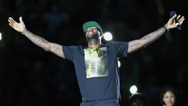 Cleveland Cavaliers' LeBron James smiles as he is introduced at his homecoming at InfoCision Stadium on Friday.