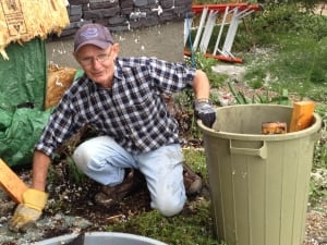 Ray Hill cleans up debris