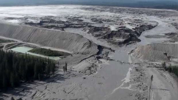 "An aerial view of the Mount Polley mine tailings pond shows the area where the earthen wall gave way early on the morning of Aug. 4. A letter posted on the website of Knight Piésold Consulting said the Vancouver company had warned mine owners in 2011 that the containment pond was ""getting large."""