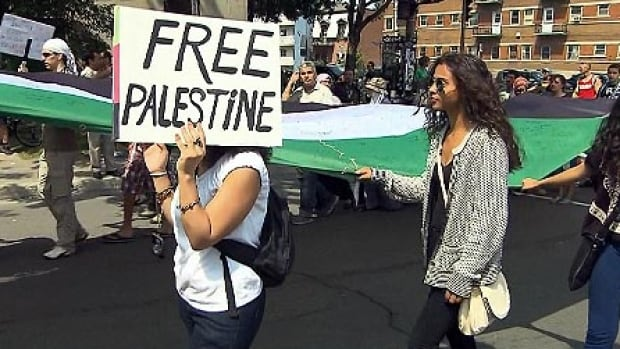 Thousands of protesters gathered in downtown Montreal in support of the Palestinian people in Gaza. They carried a massive Palestinian flag to Guy-Favreau Complex, home of the Canadian government in Montreal.