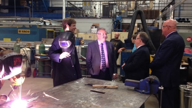 Confederation College President Jim Madder (centre) speaks with MPP Michael Gravelle and Mayor Keith Hobbs about the importance of trades programs, such as welding, during a recent funding announcement.