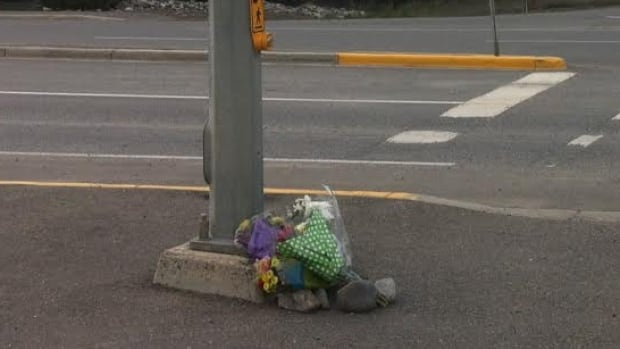A makeshift memorial at the Whitehorse intersection where two people died in a car crash Aug. 9. Four people were in the car at the time.
