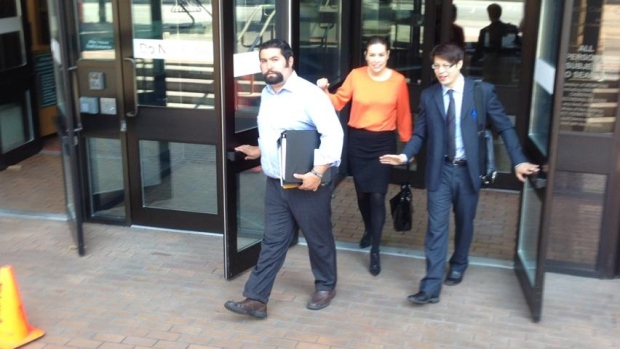 Serhat Seyhoglu (on left), the contractor charged by CBSA in reality TV raid leaves Vancouver Provincial Court after facing charges.