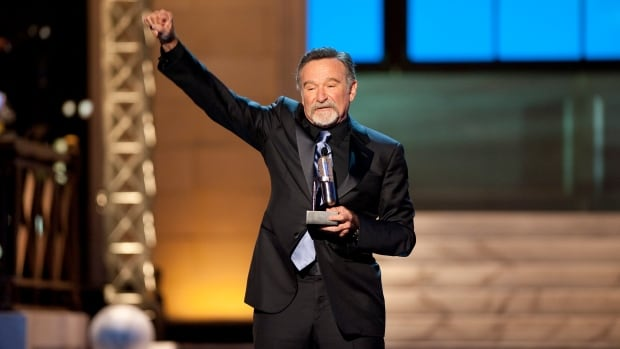 Comedian Robin Williams, shown in 2012, is remembered by fellow celebrities as a comic genius and a kind person.