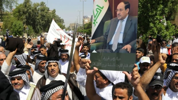 Shia Iraqis loyal to Prime Minister Nouri al-Maliki chant pro-government slogans and wave national flags, to show support Maliki, who is trying to cling to power despite internal and international pressure.