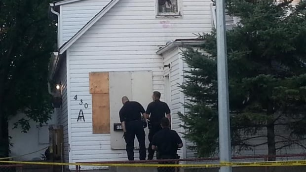 Police knock on the door of a home on Pritchard Avenue, but won't say what they are investigating.