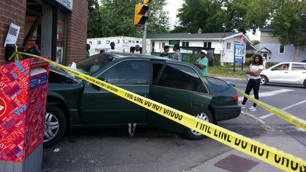 A car slammed into the front entrance of the All Africa Market on Monday.