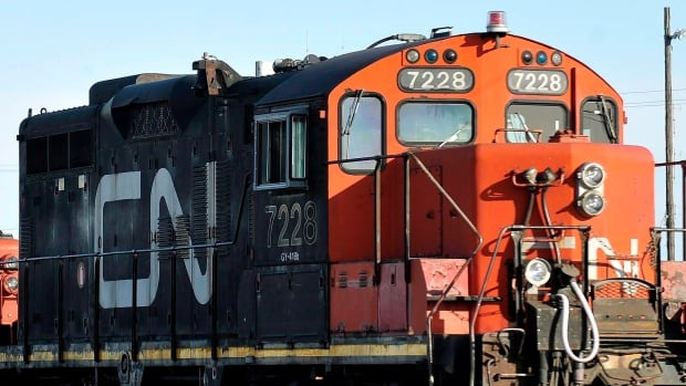 A CN locomotive goes through the CN Taschereau yard in Montreal, Saturday, Nov., 28, 2009. Canada's largest railway has received notice that one of its major unions could go on strike as early as Saturday.