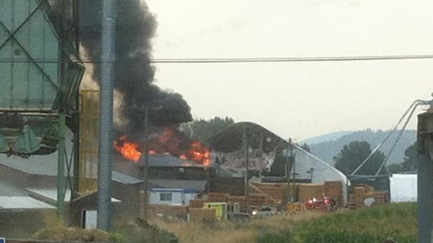 Black smoke billows out as fire rips through the Coldstream Lumber mill near Vernon Tuesday morning.