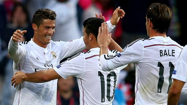 From left, Cristiano Ronaldo of Real Madrid celebrates with teammates James Rodriguez and  Gareth Bale after scoring the opening goal during the UEFA Super Cup against Sevilla FC at Cardiff City Stadium on Tuesday in Cardiff, Wales. Ronaldo scored both goals in a 2-0 victory.