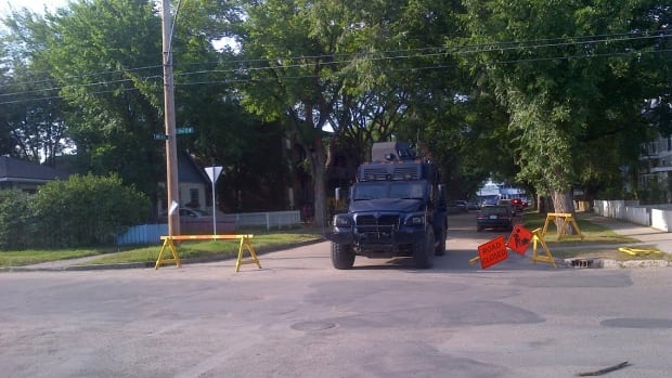 An armoured vehicle leaves the scene of a standoff at the 100 block of Avenue O South after a 20-year-old man surrendered Tuesday evening.