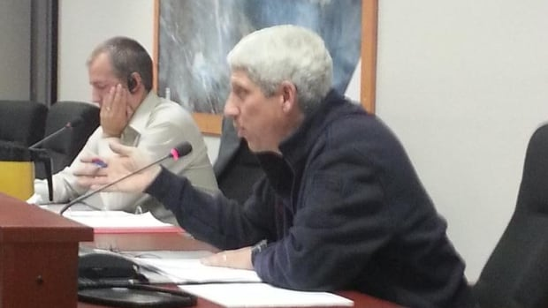 Iqaluit Fire Chief Luc Grandmaison speaks at a city council meeting Aug. 12. He says crews will begin fighting the city's dump fire during the week of Aug. 24.