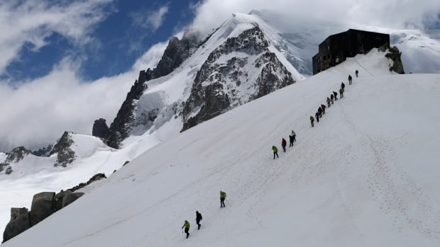 People on a roped walk are seen near Mont Blanc in 2012. Five bodies were found in the French Alps Wednesday morning and the body of the sixth victim was later pulled out from the bottom of a crevasse.