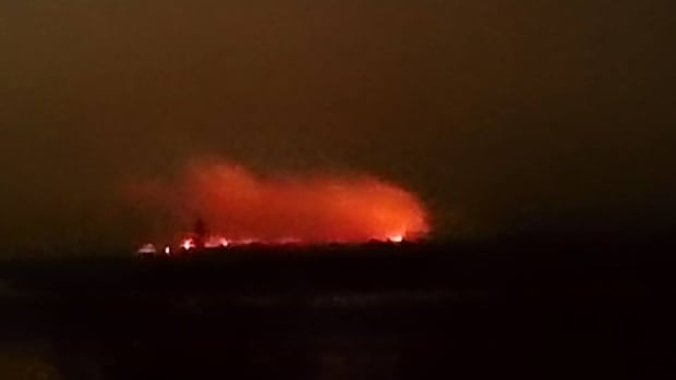 A forest fire near Mud Lake Tuesday night as seen from across the Churchill River.