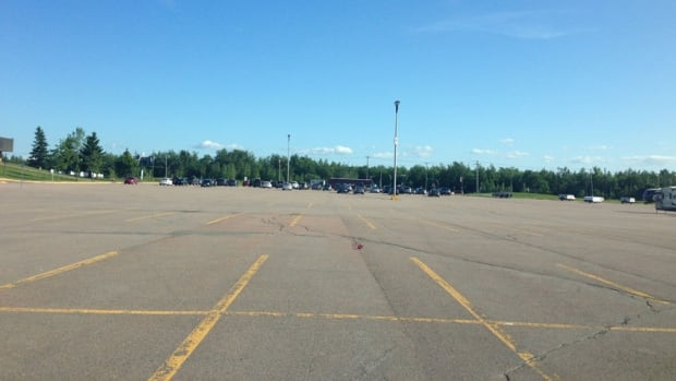 The Moncton Coliseum's parking lot is nearly empty during the FIFA Under-20 Women's World Cup games, with many fans opting out of the shuttle bus option and parking on side streets around the University of Moncton stadium.