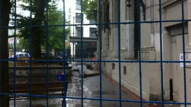 A crumbling piece of Vancouver history: The Merchants Bank at 1 W. Hastings lost part of its façade the morning of Wednesday, August 13. Pieces fell onto Pigeon Park below, which was fenced off by City of Vancouver staff.