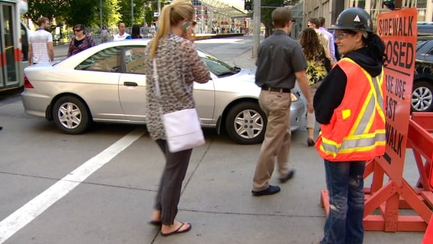 A flag person telling people to walk straight ahead instead of jaywalking is now at the corner of Seventh Avenue and Fifth Street southwest where construction has been taking place since the beginning of the summer. The city also moved a nearby bus stop after more than 90 people received jaywalking tickets Tuesday.