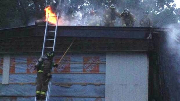 Firefighters battle a blaze on Penny Drive in west Ottawa on Wednesday.