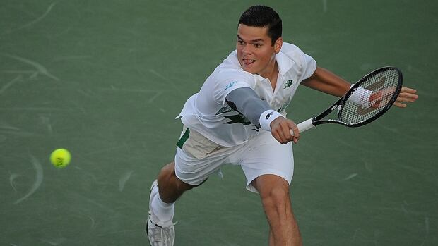 Milos Raonic returns to Robby Ginepri during their second-round match of the Western & Southern Open on Wednesday in Cincinnati, Ohio. Raonic won in straight sets, 6-2,