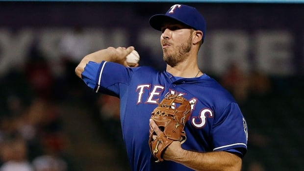 Rangers first baseman J.P. Arencibia pitches in relief in the ninth inning Wednesday night against Tampa Bay. The one-time Blue Jays catcher held the Rays scoreless, allowing a Logan Forsythe single and throwing six of his 10 pitches for strikes.
