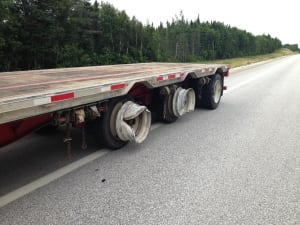 Transport truck in crash near Howley