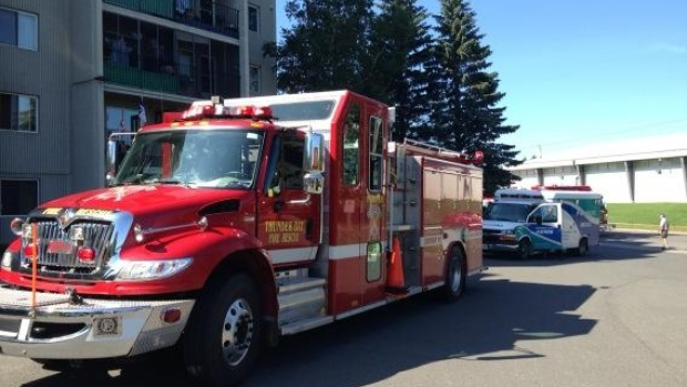 Fire crews attend to a fire call outside Elizabeth Court in Thunder Bay, after the contents of a garbage can caught fire. A maintenance worker put the fire out.