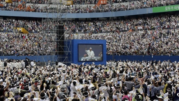 Pope Francis is seen on a huge screen for the Mass of Assumption of Mary at Daejeon World Cup stadium in Daejeon, south of Seoul, South Korea on Friday.