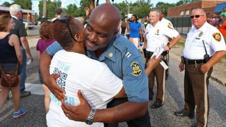 Michael Brown shooting: Tensions ease as state police take ...