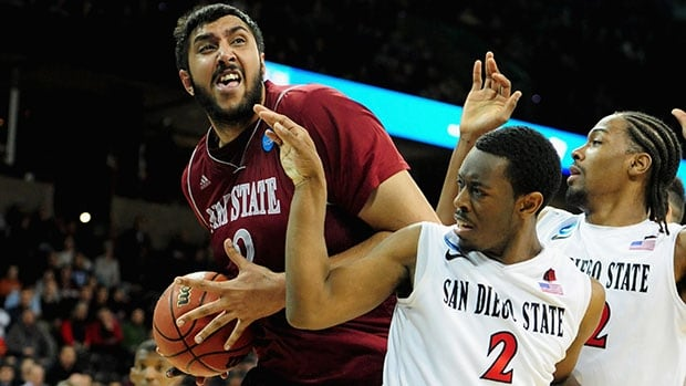 Sim Bhullar, left, averaged 10.2 points, 7.2 rebounds and 2.9 blocks as a collegiate player at New Mexico State.