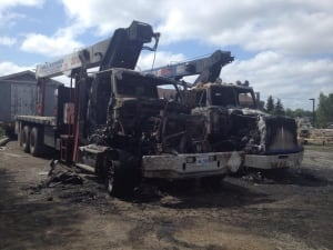 boom trucks destroyed in fire at construction yard in Grand Falls-Windsor